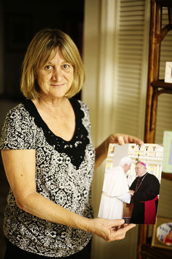 Wenski&#039;s sister, Mary Engle, shows off a photo of her brother meeting Pope Benedict XVI at the Vatican in June.
