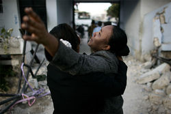 A young woman grieves after she learns her mother and father perished in the earthquake.