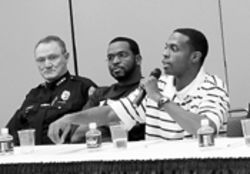 "Miami Police Chief John Timoney (left) and rapper  Luther ""Luke"" Campbell listen to Cedric Mohammed  (right)"