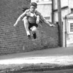 Billy Elliot (Jamie Bell) leaps at the opportunity to practice his ballet moves