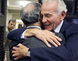 Norman Braman (right) hugs attorney Bob Martinez in court this past July.