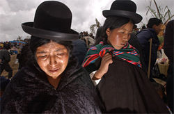 An Aymara woman weeps at her husband&#039;s tomb in November 2003, a month after Black October.