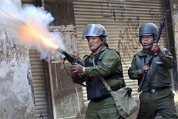 Bolivian police launch tear gas at protesters during a march through downtown La Paz.