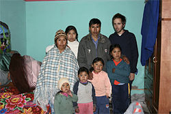 Etelvina (far left) and Eloy (center) pose  with their surviving children and Thomas Becker (far right)