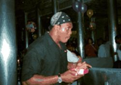 Goodbye cake: Former Dolphins safety Louis Oliver savors a bite of the sweet life at his final party at the Marlin, Twelfth and Collins