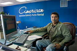 Luis Elera claims his exotic car rental business was the first on the crowded airport strip.