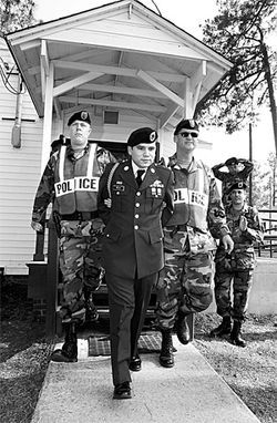 On May 21, 2004, two military police officers led Camilo away in handcuffs following his conviction on desertion charges