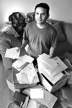 Camilo sits on boxes of correspondence, hundreds of letters he received from supporters while imprisoned at Fort Sill, in Oklahoma