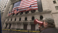 Michael Moore and his bullhorn outside the New York Stock Exchange.