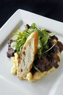 Three-hour short ribs cooked in red wine and served with creamy polenta.