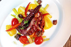 Cecconi's grilled octopus, lemon, capers, and olives