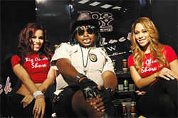 Officer Bow-leg flanked by Big Chuck Girls, Bandolera (left) and D