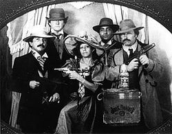 The gang in a gag photo taken in New Orleans, from left: Rafael Cardona Salazar, Mickey Munday, Rafa&#039;s wife Odelia, Medell&amp;iacute;n Cartel associate &quot;El Negro,&quot; and Max.