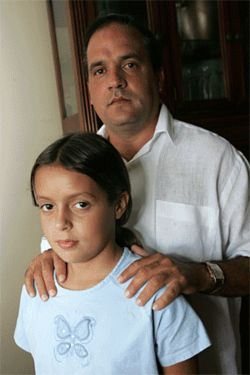 Ex-political prisoner Juan Amador (right), the man who  sparked the book ban firestorm, with his daughter Yilen.  Amador objected to the Spanish-language version of A  Visit to Cuba