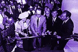 Plummer (far right) and former Mayor Steve Clark (wearing glasses) often competed for scissors at ribbon-cutting ceremonies