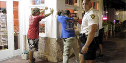 Hammonds, far left, and his friends face the wrath of Miami Beach police.