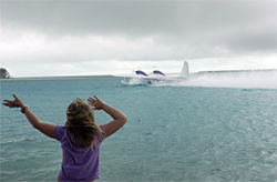 One day after the crash, Kalia Keefe, 7, waved goodbye to one of the last Chalk's flights to leave Bimini