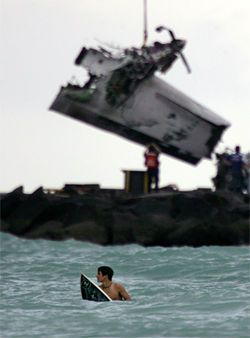The crash happened over Government Cut on South Beach, in view of surfers, where wreckage is pulled from the water days after the crash.