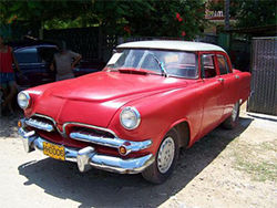 Interested in a cherry-red 1955 Plymouth? It's listed for 5,000 pesos ($5,300).