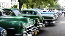 Private taxis line a Havana street.