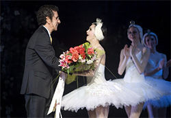 Pedro Pablo Pe&amp;ntilde;a hands a bouquet to Almeida after the show
