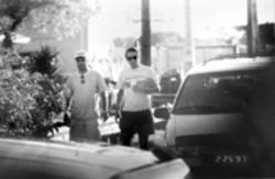 The FBI says this surveillance photo was taken in Key West shortly after Gerardo Hernandez (left) passed a blue plastic bag, possibly containing floppy disks, to Antonio Guerrero