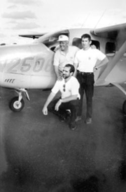 Basulto poses in front of his Cessna with Wasps Roque and Rene Gonzalez (kneeling)