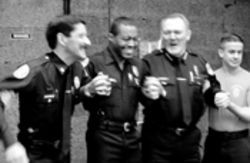 Miami Police Chief John Timoney (second from right) tastes the Taser