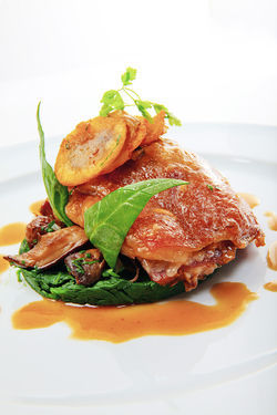 Duck confit. View our DB Bistro Moderne slide show.