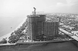 One Bal Harbour, a 26-story luxury condominium and  hotel complex at the mouth of Haulover Inlet, became a  temporary tomb for three workers. The sold-out  building's 85 condominium apartments went for $1  million to $12 million each