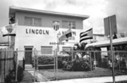 Still flying on June 9, the inverted flag at this Lincoln-Martí School makes Demetrio Perez's politics perfectly clear