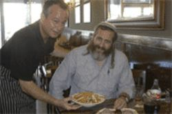 Sam's waiter Les Donaldson serves Shmuek Sackett a Chinese chicken salad