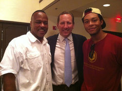 Video instructor Dwayne Taylor (left) and his student Andrew Spence (right) pose with John Textor in West Palm Beach.