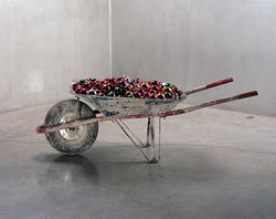 Gabriel Kuri&#039;s wheelbarrow of Christmas ornaments.