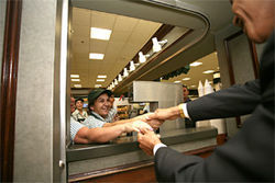 Shaking hands at Miami International Airport's Versailles restaurant.