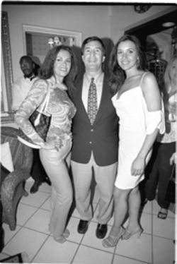 Mr. Big: Free at last to womanize, Carollo caresses the hips of Mexican songstress Lucía Méndez (left) and of former Miss Florida Lissette Gonzalez