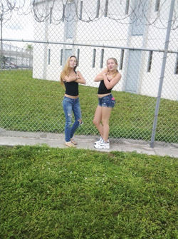 Montes (left) and Erica Avery, 16, pose in front of the Paul Rein Detention Center, where Erica's father awaits trial for grand theft auto and heroin possession.