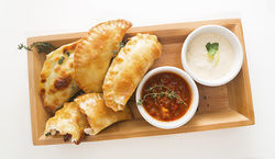Oxtail, oyster, and alligator empanadas
