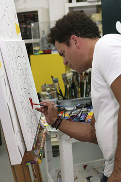 Romero Britto works inside his unmarked Wynwood studio.