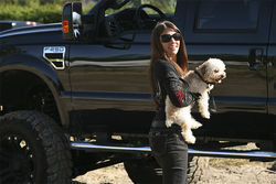 Rob's wife Laura and their miniature poodle.