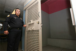 Chief Fulgueira next to the cell that Peter once claimed he was beaten in