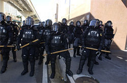 November 20, 2003, approximately 50 riot police dressed in black marched north along NE First Avenue