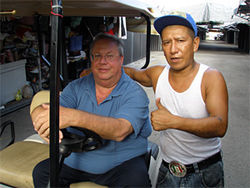 Scott Miller (left) at the flea market with shoe vendor Carlos Barquero