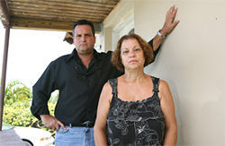 Private investigator José Trujillo, with Santo's mother Mirta, believes Hialeah Police homicide detectives ignored leads that would prove Santo's innocence.