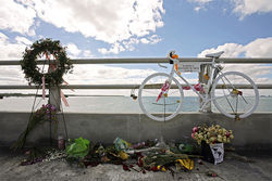 A &quot;ghost bike&quot; hangs in memory of Christophe Le Canne.