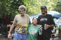 Mark (left), a Democrat, and friends live in the woods outside a DeLand flea market.
