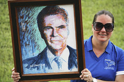 A visitor at the Apopka rally shows off a likeness of the Mormon superstar.
