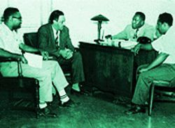 At an Overtown meeting in 1950, NAACP lawyer Thurgood Marshall met with Johnson (behind desk) and Graves (right). Garth Reeves observed