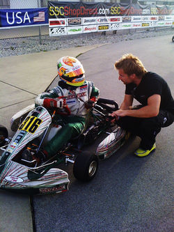 Tristan, in car, gets some pointers from Jay, his coach. Many drivers don't have the benefit of professional coaching.