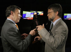 Juan Manuel Santos (left) beat Antanas Mockus in Colombia thanks to the help of J.J. Rendón.